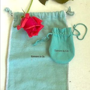 To Tiffany and Co. soft drawstring pouches